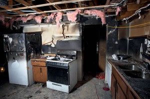 Charred kitchen in a house gutted by fire