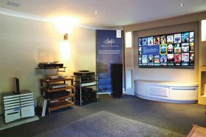 Linn turntable and amplifiers sit alongside Kaleidescape and Maranz. OLED TV is by LG