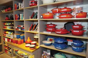 Crockery and pots and pans are displayed upstairs