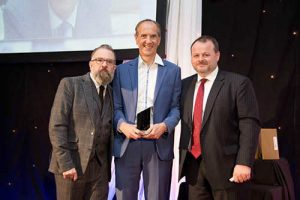 L to R: ERT editor Sean Hannam, Hughes managing director Robert Hughes, and Owen Watters, chief executive of Roberts Radio, which sponsored the award